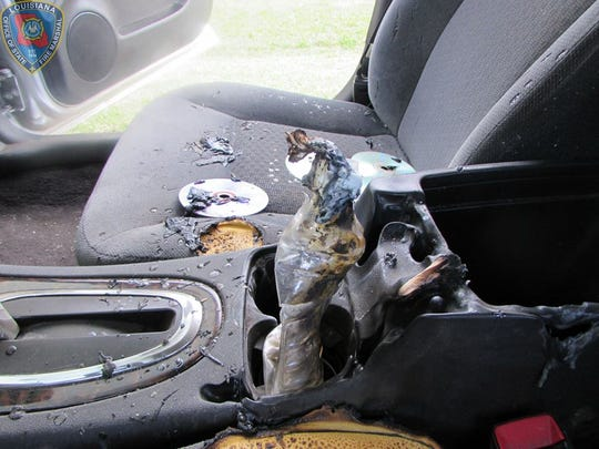 The suspect saidthere was an uncapped drink bottle in the console cup holder. The bottle containedgasoline with a tissue in the mouth of the bottleat the time of the fire.