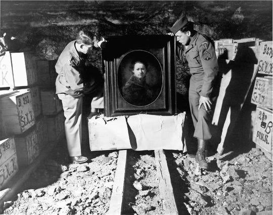 Photo no. 38038Harry Ettlinger, of Rockaway Township, on right, and Lt. Dale Ford (on left) worked for the Monuments Men in 1946 when they uncrated a Rembrandt self portrait that had been stored in a salt mine in Germany.Photo from National Archives and Records Administration, College Park, MD