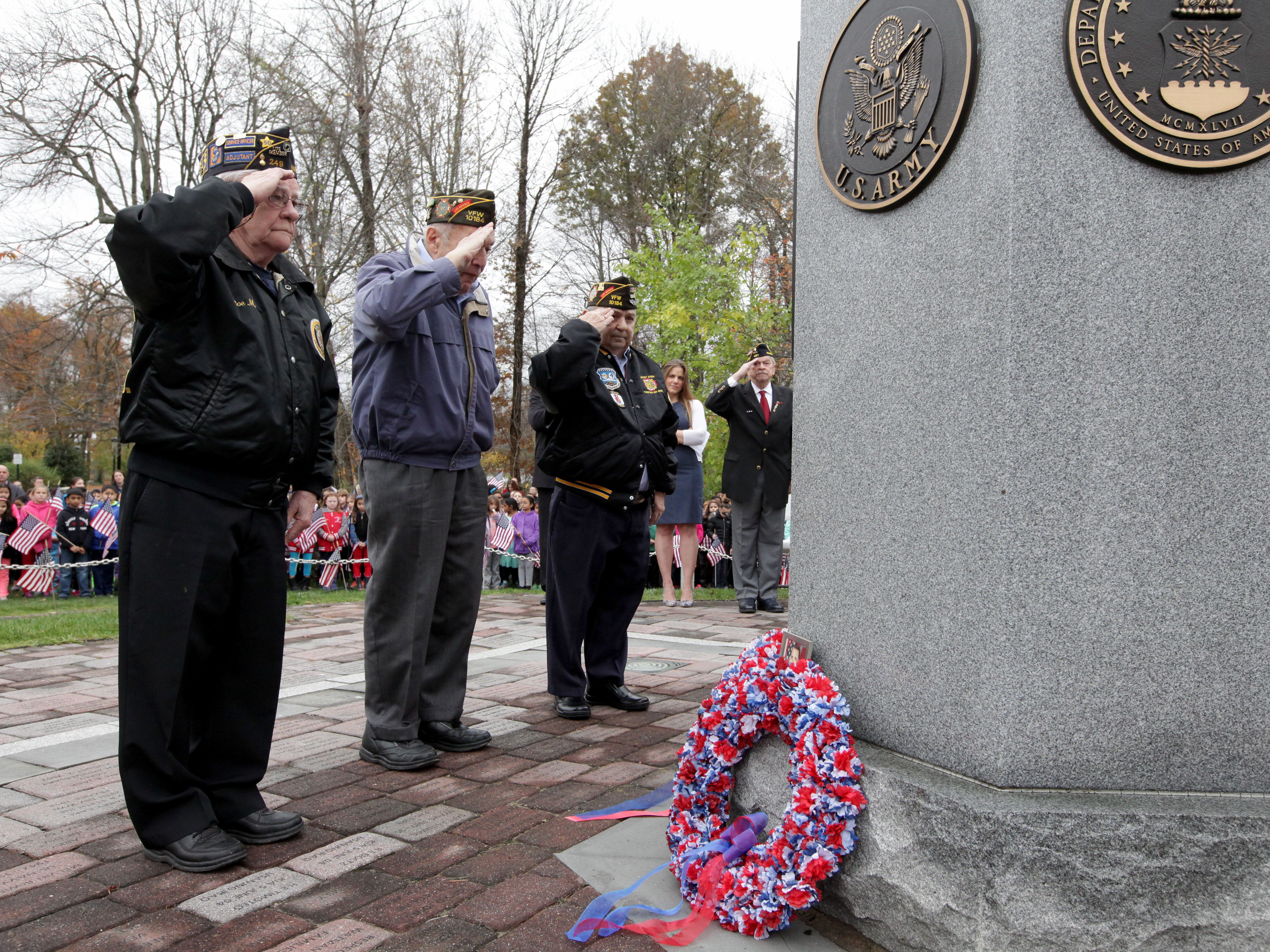 Veterans, (l-r) Joe Minsavage, American Legion Post 249, Harry L. Ettlinger, Monuments Men, and Gary Erdmann, VFW Post 10184, take part in the Laying of the Wreaths during Parsippany's Veterans Day ceremony held at Veterans Memorial Park , November 11, 2015. Mary Iuvone/For The Daily Record