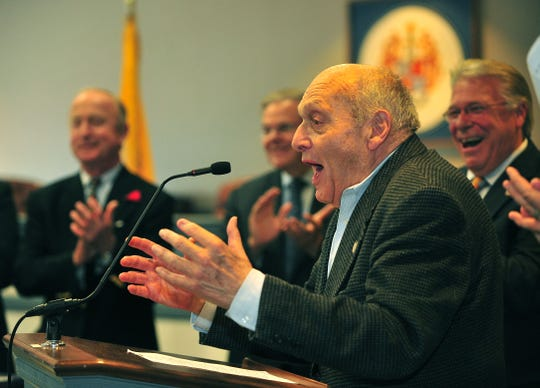 Army veteran Harry Ettlinger of Rockaway Township, speaks to the crowd. Morris CountyÕs annual Memorial Day ceremony, while in the background Congressman Rodney Frehlinghuysen, Sen. Robert Menendez deputy freeholder director David Scapicchio applaud. and sponsored by the Morris County Board of Chosen Freeholders, is held at the Morris County Administration Building. The keynote speaker is Army veteran Harry Ettlinger of Rockaway Township, one of the ÒMonument MenÓ of World War II, a group of 350 people from 13 nations who worked tirelessly to recover and return cultural treasures that were stolen by the Nazis. Freeholders also present the Morris County Distinguished Military Service Medal to 11 Morris County veterans in recognition of their service to our nation.