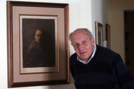 Harry Ettlinger stands in front of a Rembrandt self-portrait reproduction at his home in Rockaway, NJ, the picture is a constant reminder of his days with the Monuments Men, an allied forces team tasked with returning looted art to its rightful owners at the end of WW II. January 24, 2014, Rockaway, NJ, Staff Photographer/Bob Karp MOR 0124 Rockaway Monuments Men
