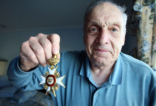 "Rockaway, Sept. 19, 2007 -- Harry L. Ettlinger was one of the ""Monuments Men"" who guarded and repatriated artwork stolen by Nazis during World War II. Ettlinger holds a medal of the Archduke of Hesse which he got from Hitler's Eagle's Nest Retreat - Berchtesgaden, Germany. He said that he handled works of art that were worth $2 million in the 1940s and never had a thought to take anything -- the group was dedicated to returning all of the stolen artwork.