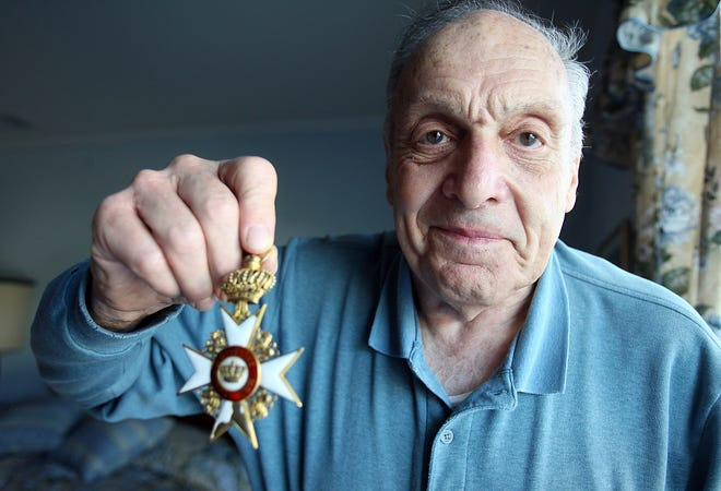"""Rockaway, Sept. 19, 2007 -- Harry L. Ettlinger was one of the """"Monuments Men"""" who guarded and repatriated artwork stolen by Nazis during World War II. Ettlinger holds a medal of the Archduke of Hesse which he got from Hitler's Eagle's Nest Retreat - Berchtesgaden, Germany. He said that he handled works of art that were worth $2 million in the 1940s and never had a thought to take anything -- the group was dedicated to returning all of the stolen artwork.Karen Mancinelli photo/2007"""