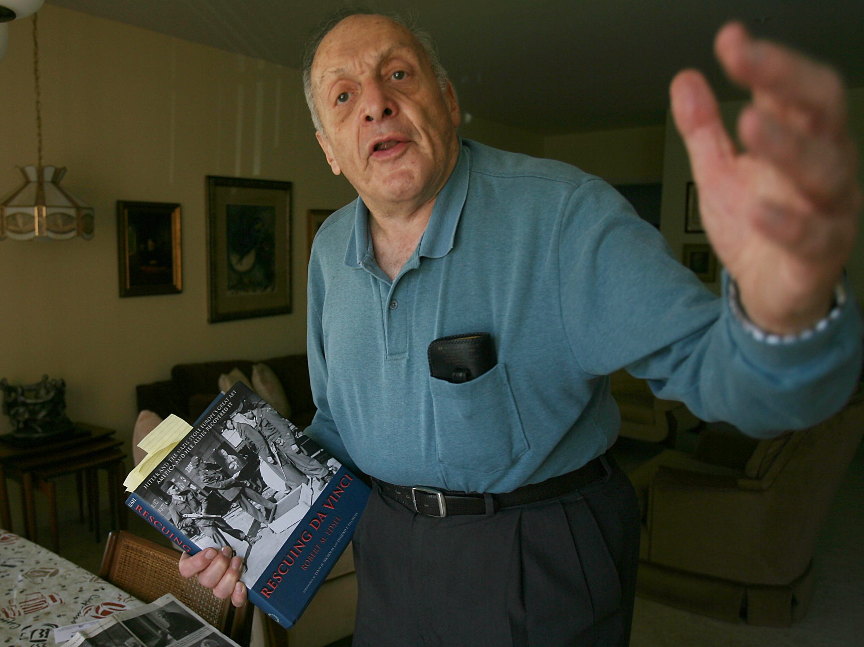 "Rockaway, Sept. 19, 2007 -- Harry L. Ettlinger was one of the ""Monuments Men"" who guarded and repatriated artwork stolen by Nazis during World War II. He holds Robert M. Edsel's book Rescuing Da Vinci.