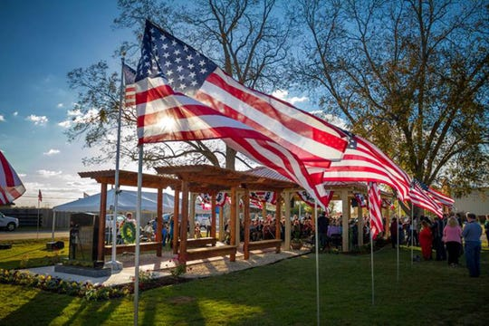 he Town of Pike Road Veterans Memorial at Veterans Park is colorful during a past veterans appreciation ceremony.