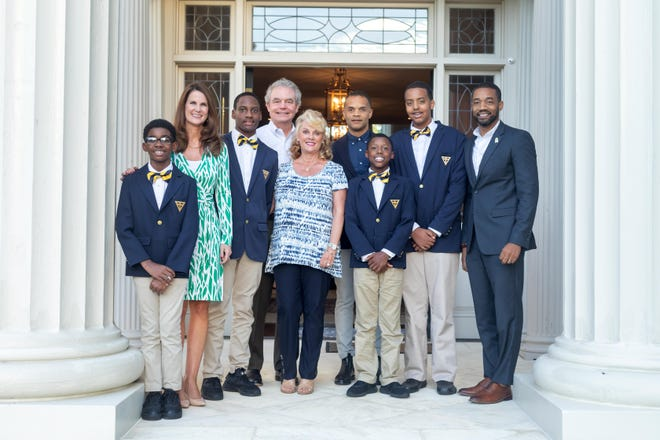 Valiant Cross Academy scholars with Kimberly Baker, Tom and Amy Methvin, and the school's founders Frederick Brock and Anthony Brock.
