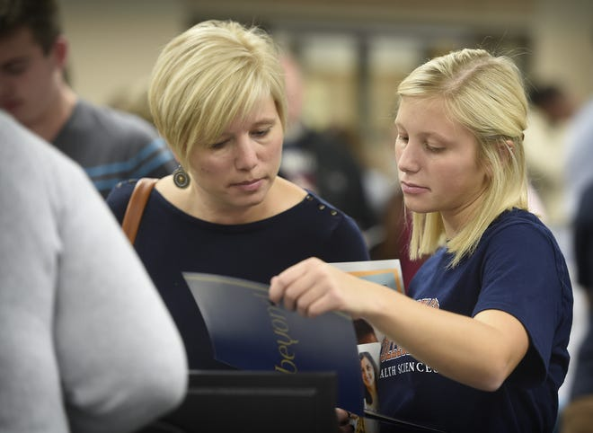 Elco High School cafeteria filled with college bound students and their parents for a opportunity to speak with college admission personal. Anna Enck, junior, came to the fair with her mom, Nicole Enck.