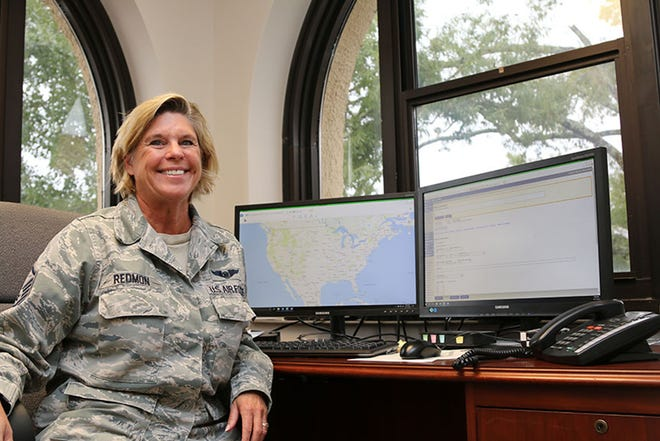 Master Sgt. Kristen Redmon's temporary office at Maxwell Air Force Base overlooks the National Operations Center at Civil Air Patrol National Headquarters. A civilian reservist at Tyndall AFB, Florida, she relocated to Maxwell following Hurricane Michael.