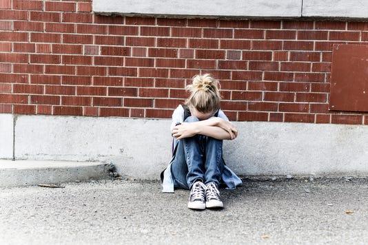 Unhappy Pre Teen Girl At School