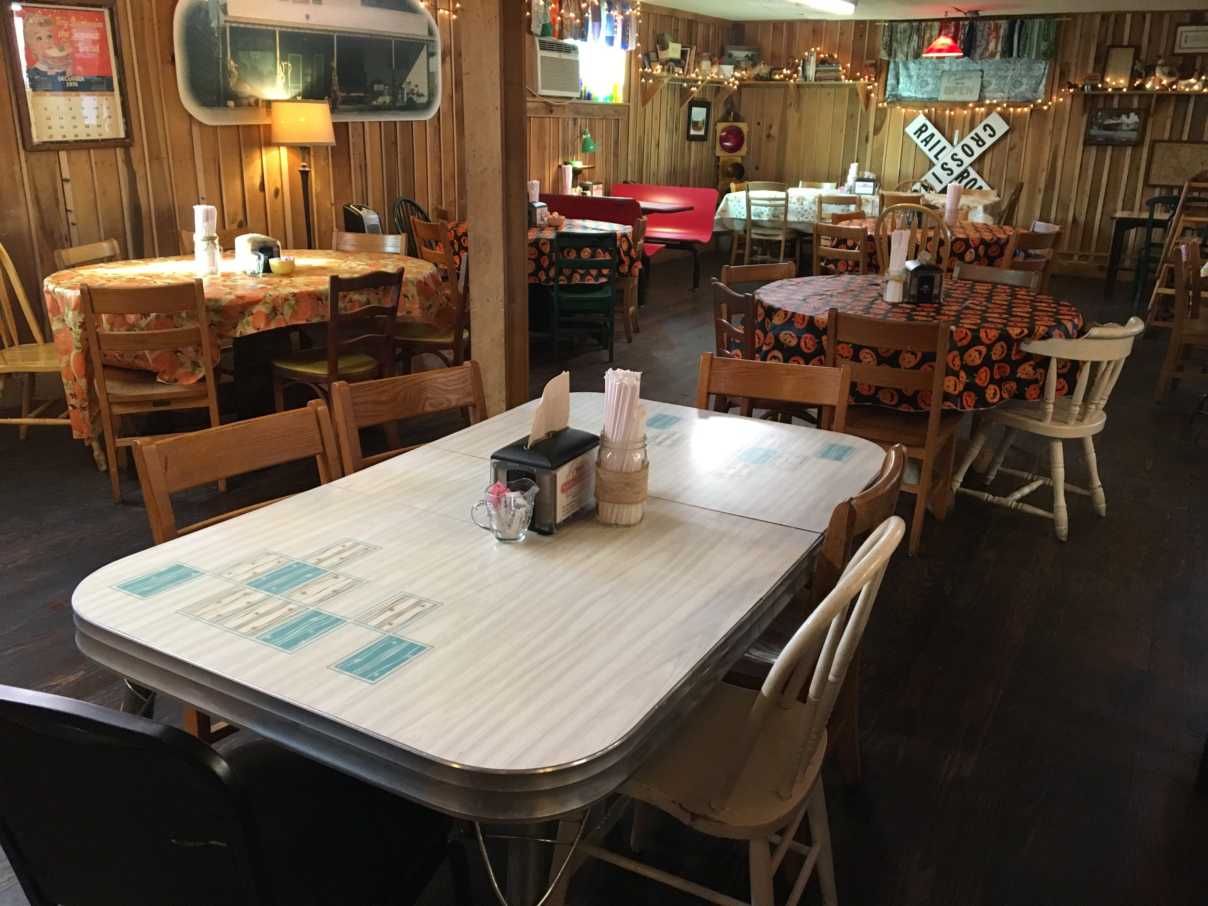 Lara Phillips uses here grandmother's kitchen table in the dining room of Miller's Grocery in Christiana.