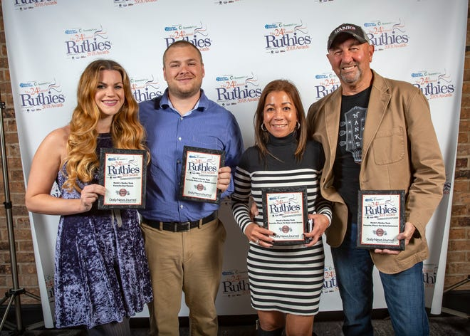 Representing Hank's Honky Tonk are, from left, Christina and Gage Estes, and owners Gina and Ken Strode. Hank's won first place as Favorite Bar/Tavern, Favorite Place for a Quick Lunch, Favorite Place to Hear Local Bands and Favorite Place for Entertainment, and was a finalist in four other categories.
