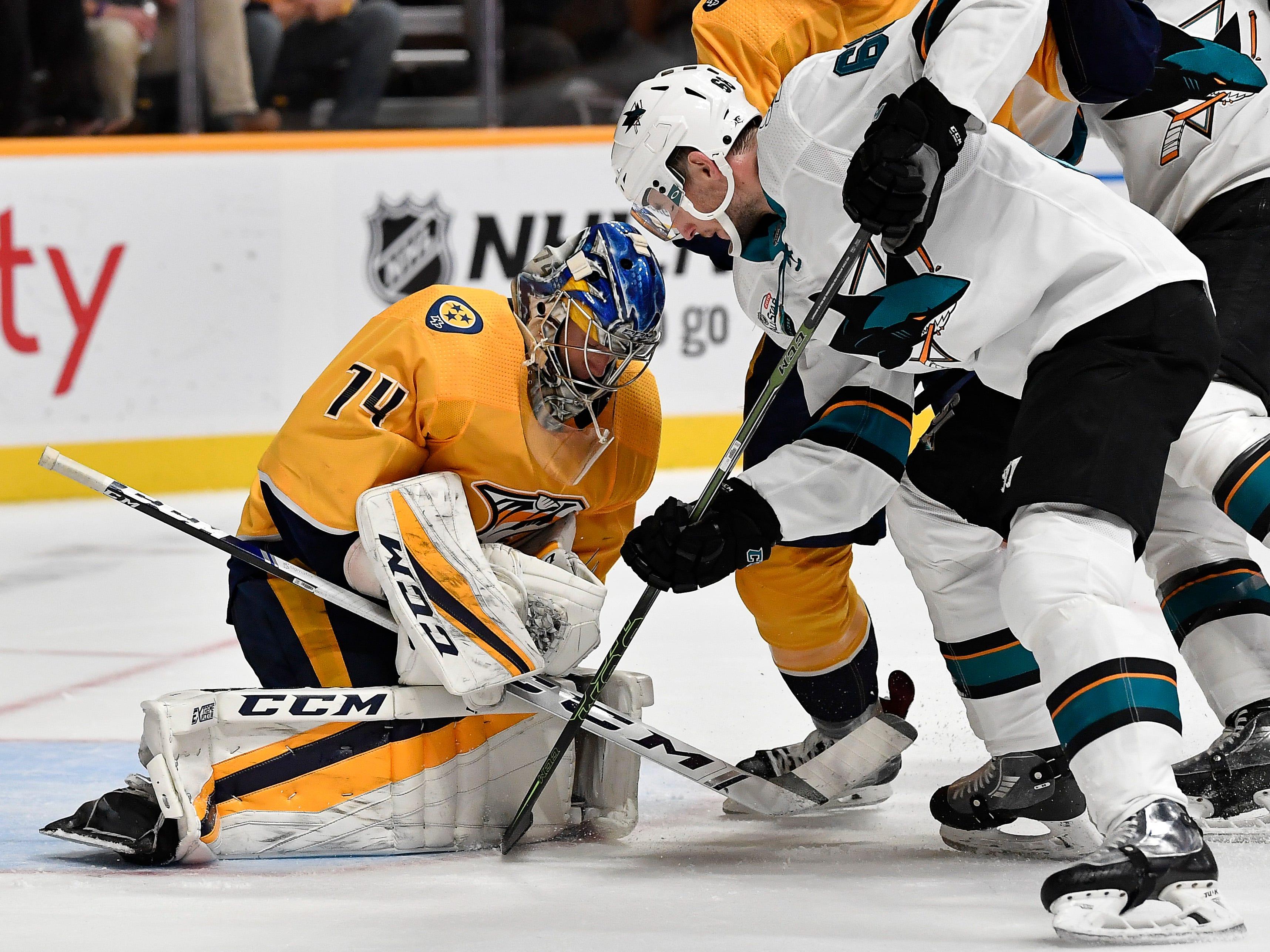 Predators goaltender Juuse Saros (74) blocks a shot by Sharks center Melker Karlsson (68) during the second period at Bridgestone Arena Tuesday, Oct. 23, 2018, in Nashville, Tenn.