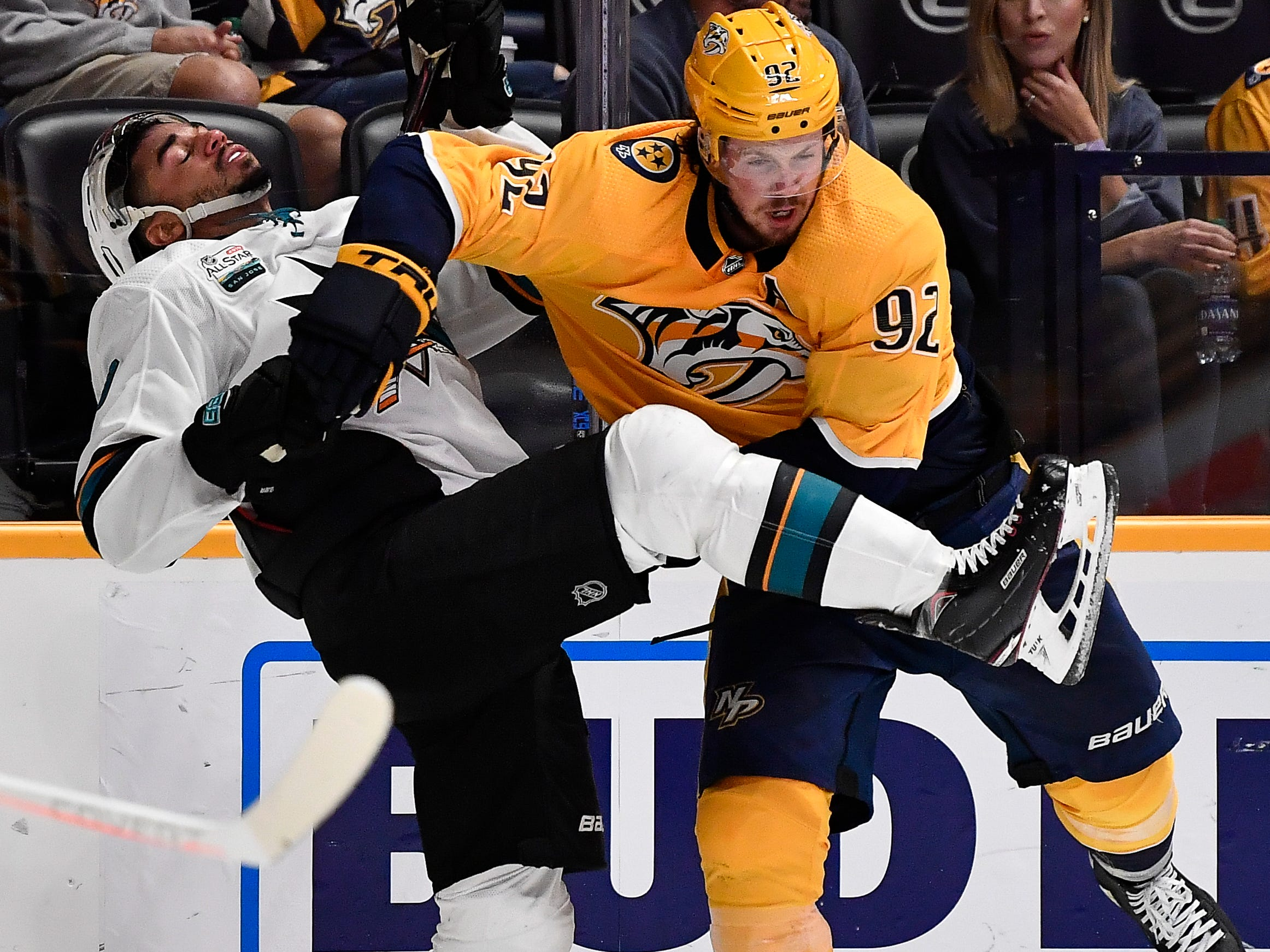 Predators center Ryan Johansen (92) checks Sharks left wing Evander Kane (9) during the second period at Bridgestone Arena Tuesday, Oct. 23, 2018, in Nashville, Tenn.