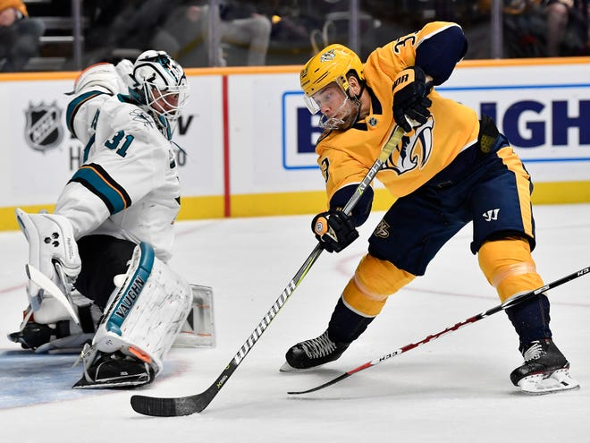 Predators right wing Viktor Arvidsson (33) shoots a goal past Sharks goaltender Martin Jones (31) during the first period at Bridgestone Arena Tuesday, Oct. 23, 2018, in Nashville, Tenn.