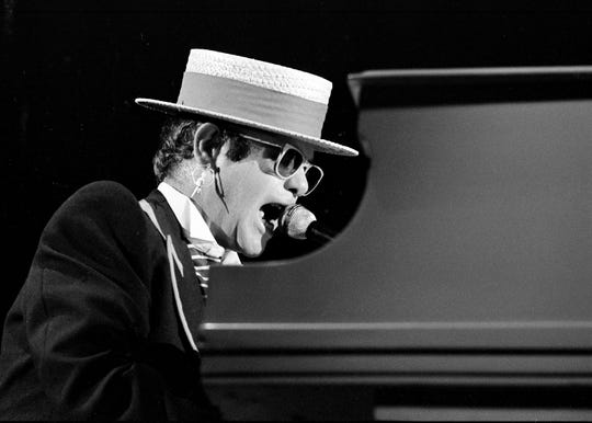 "Elton John opens his concert with ""Tiny Dancer"" after receiving a standing ovation at MTSU's Murphy Center on Oct. 7, 1984."