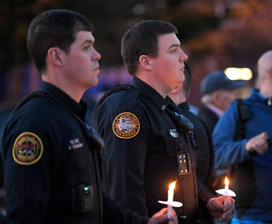 Law enforcement officers attend prayer vigil in downtown Columbia on Tuesday for the victims and surviving members of an apparent murder-suicide involving a Columbia mother and four of her children.