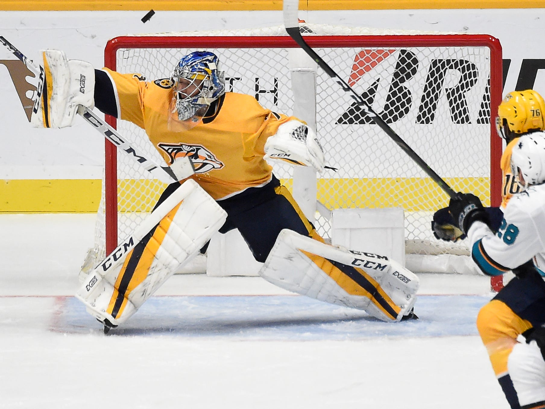 Predators goaltender Juuse Saros (74) blocks a shot on goal against the Sharks during the third period at Bridgestone Arena Tuesday, Oct. 23, 2018, in Nashville, Tenn.