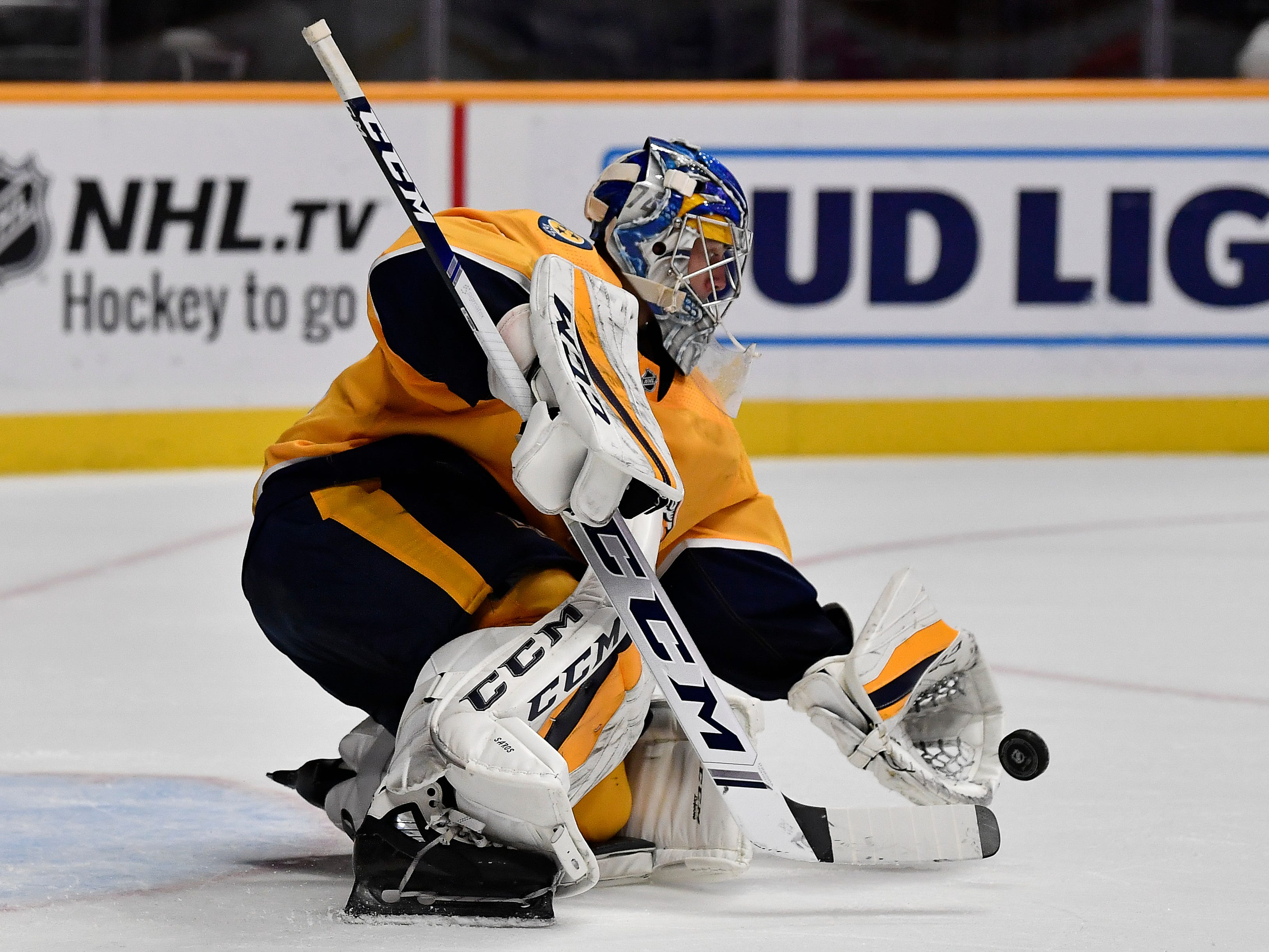 Predators goaltender Juuse Saros (74) gathers a puck as he protects the goal during the second period against the Sharks at Bridgestone Arena Tuesday, Oct. 23, 2018, in Nashville, Tenn.