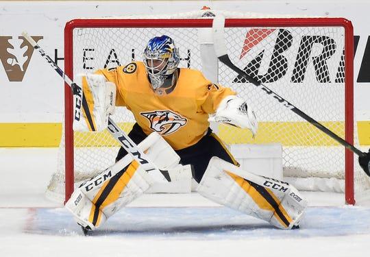 Predators goaltender Juuse Saros (74) blocks a shot on goal against the Sharks during the third period at Bridgestone Arena Tuesday, Oct. 23, 2018, in Nashville, Tenn.