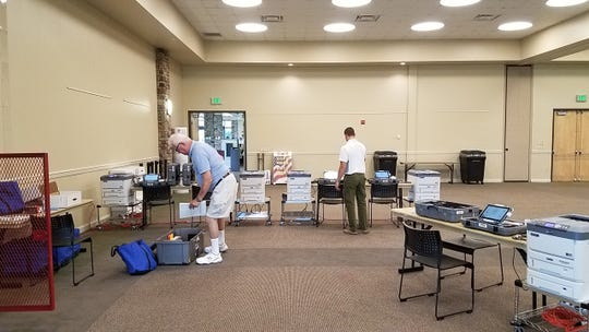 Election workers Bill Greenberg (left) and Jake Pirosseno help set up an early voting location at North Collier Regional Park, Tuesday, Oct. 23, 2018. Early voting starts in Collier County on Oct. 25, 2018, and ends Nov. 3, 2018.