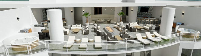 Omega's rooftop terrace common area will include two hot tubs next to the glass railing, allowing residents to relax in the tubs while enjoying water and sunset views.