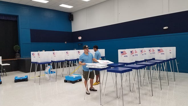 Movers help set up an early voting location at the Golden Gate Community Center, Tuesday, Oct. 23, 2018. Early voting starts in Collier County on Oct. 25, 2018, and ends Nov. 3, 2018.