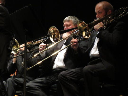 Doug Moran, founder and manager of the Heisey Wind Ensemble is also a trombone player. He was surprised during the performance with the award.