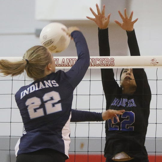 Julianna Lavner of Wayne Valley hits the ball past Dania Ayala of Passaic Tech in the 2018 Passaic County girls volleyball final. (Chris Pedota/@chrisp47)