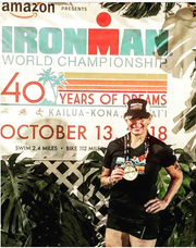 Oakland's Mary Ellen Loranger with her finisher medal from the Iron Man world championship in Kailua-Kona earlier this month.