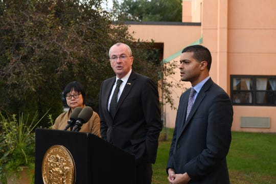 New Jersey Governor Phil Murphy speaks about the adenovirus outbreak during a press conference at The Wanaque Center for Nursing and Rehabilitation on Wednesday, October 24, 2018. (right) New Jersey Department of Health Commissioner Dr. Shereef Elnahal. (left) New Jersey State Epidemiologist Dr. Christina Tan.