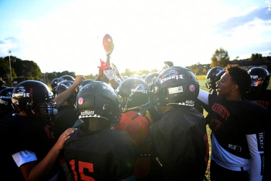 Shaqir Herbert and the John F. Kennedy High School football team huddle up at the start of practice on Wednesday, Oct. 24, 2018, in Paterson. Herbert is one of 10 tri-state finalists for the 2018 USA Football Heart of a Giant Award.