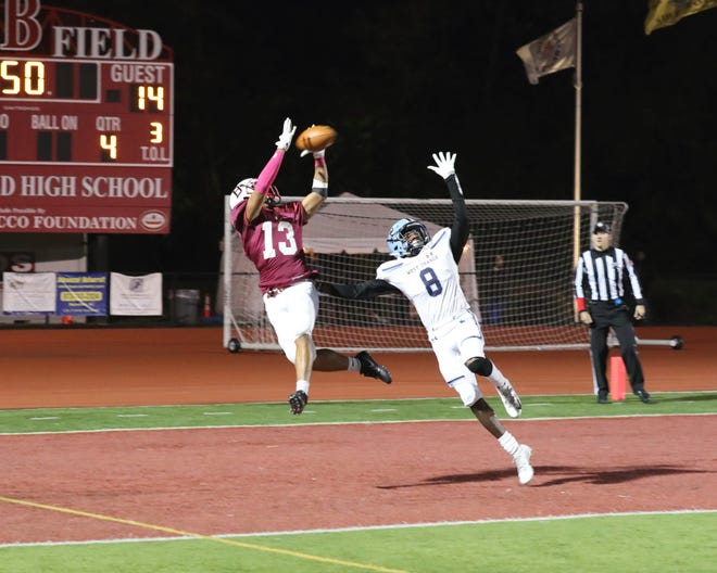 Bloomfield's William Robinson catching the tying touchdown pass in the fourth quarter.