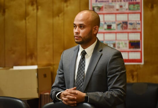 Jose Urena, Paterson cop who is accused of leaving the scene of a fatal hit-and-run that killed JaQuill Fields in 2015 and injured his brother, Ameen, is seen prior to the opening statements in his trial at the courtroom of Judge Adam E. Jacobs, photographed at Passaic County Superior Court in Paterson on 10/23/18.