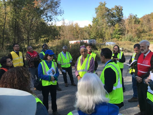Federal Environmental Protection Agency and New Jersey Department of Environmental Protection officials, including Catherine McCabe (blue hat) went on a rare Oct. 23, 2018 tour of the fenced-off Ringwood Mines Superfund.