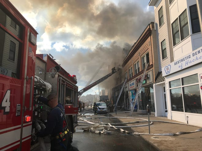 Firefighters in are battling a blaze that broke out in a Hackensack furniture store on Main Street.