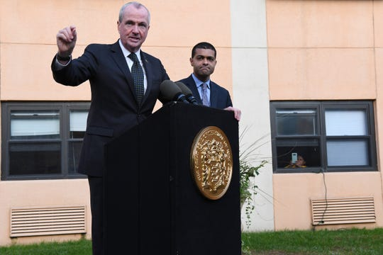 New Jersey Governor Phil Murphy speaks about the adenovirus outbreak during a press conference at The Wanaque Center for Nursing and Rehabilitation on Wednesday, October 24, 2018. New Jersey Department of Health Commissioner Dr. Shereef Elnahal looks on.