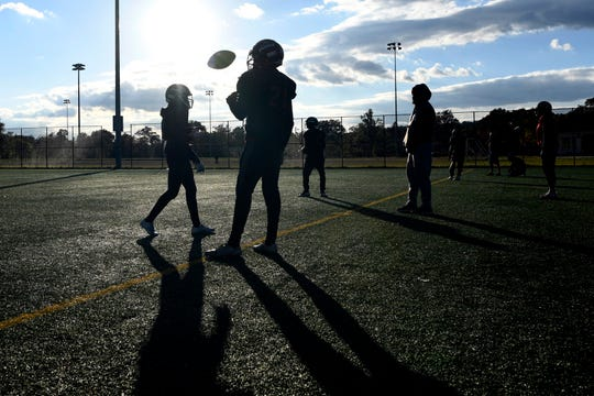 Kennedy quarterback Shaqir Herbert juggles the ball during practice on Wednesday, Oct. 24, 2018, in Paterson. Herbert is one of 10 tri-state finalists for the 2018 USA Football Heart of a Giant Award.