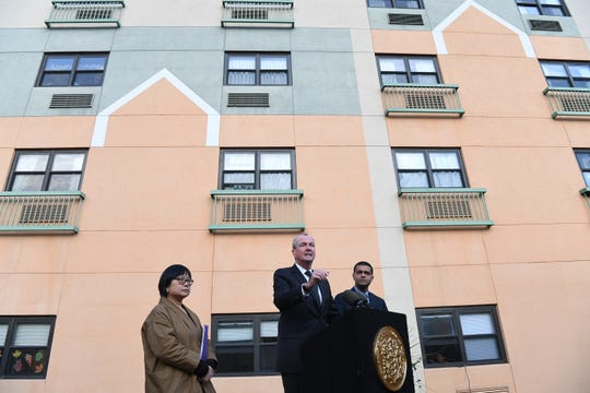 New Jersey Gov. Phil Murphy speaks about the adenovirus outbreak at the Wanaque Center for Nursing and Rehabilitation on Oct. 24, 2018, at the center in Haskell, New Jersey. New Jersey's state epidemiologist, Dr. Christina Tan, is at left;  the state Health Department's commissioner, Dr. Shereef Elnahal, is at right.