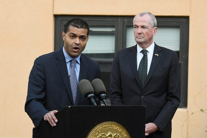 New Jersey Department of Health Commissioner Dr. Shereef Elnahal speaks about the adenovirus outbreak during a press conference at the The Wanaque Center for Nursing and Rehabilitation on Wednesday, October 24, 2018. New Jersey Governor Phil Murphyl looks on.