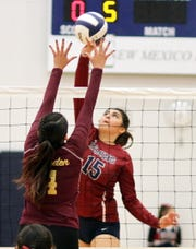 Senior Lady 'Cat outside hitter Jolene Perez (15) sparked a pair of Deming rallies on Tuesday against Gadsden High.