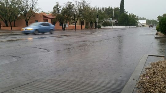 A large puddle is seen on Alameda Avenue in Las Cruces on the afternoon of Tuesday, Oct. 23, 2018, during a heavy rain storm that struck Doña Ana County.