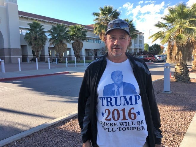 David Merry, 62, shows the T-shirt he was wearing when he presented himself to cast a ballot during early voting at the Doña Ana County Government Center.