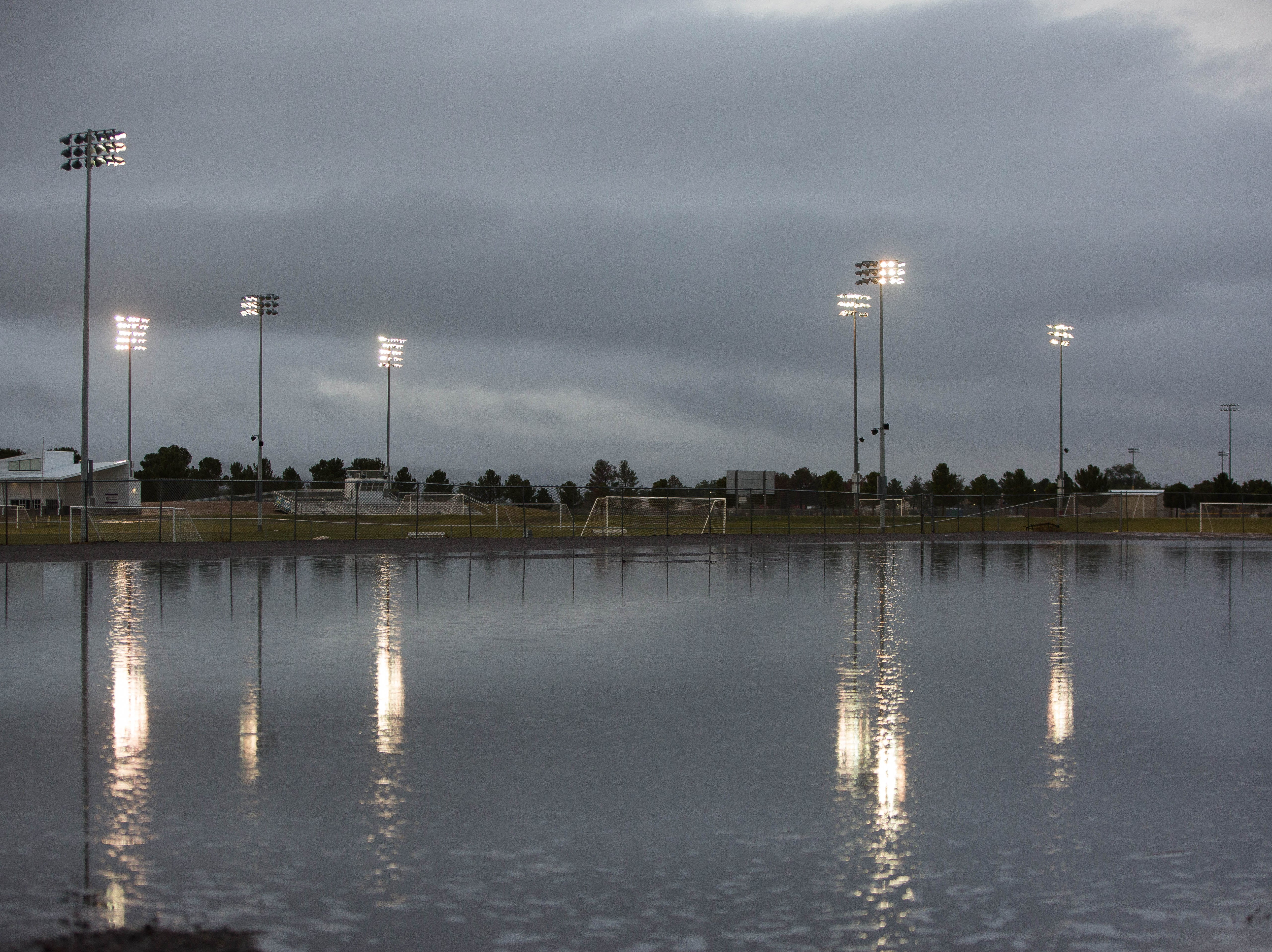 Heavy rainfall in the Las Cruces area Tuesday, flooded fields and parking lots around Doña Ana County, seen here is a gravel lot filling with water Tuesday night near the Field of Dreams. The rains also filled arroyo in the area including one in the Picacho Hills area. Tuesday October 23, 2018.