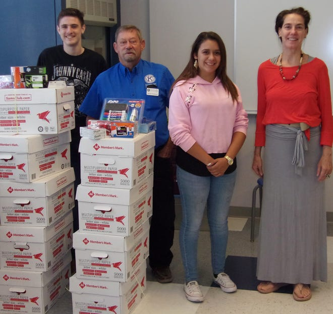 Kiwanis Club of Las Cruces delivered $500 worth of school supplies to Alma d'Arte Charter High School. Pictured, from left, are Joseph Frietze, student; Kiwanis Club secretary John Northcutt; Jennie Tankesly, student, and school principal Holly Schullo.