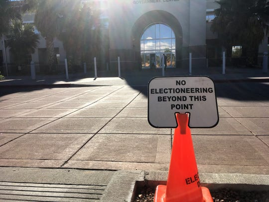 A cone marks the boundary for signs, apparel, or any materials 100 feet from the entrance to the polling place at the county government center during early voting, October 24, 2018.