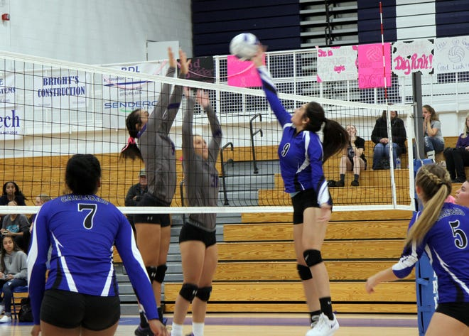 Serena Rodriquez goes for a tip against Clovis during the first set of Tuesday's match.