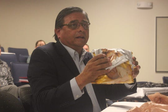 Carlsbad Mayor Pro Tem Eddie Rodriguez discusses volume tracking at the Waste Isolation Pilot Plant, using a bag of chips as a prop, Oct. 23, 2018 at New Mexico State University Carlsbad.