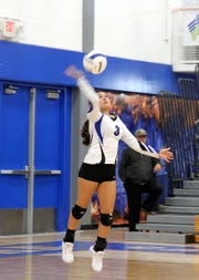 Marissa Reyes serves during the second set of Tuesday's match against Clovis.