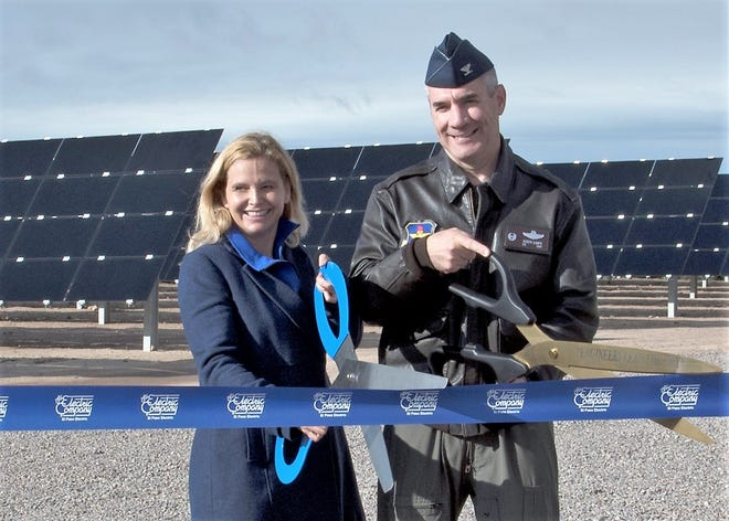 Col. Joseph L. Campo (right), 49th Wing commander, and Mary Kipp (left), El Paso Electric CEO, cut a ribbon at the solar array opening ceremony Oct. 19 on Holloman Air Force Base, N.M. The solar array is made up of almost 56,000 thin-film modules that will generate enough electricity to power more than 1,700 homes annually, prevent emissions by over 9,000 metric tons and save approximately nine million gallons of water.