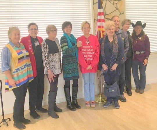 Yvette Herrell, in turquoise scarf, spoke for a crowd at the Federated Republican Women of Lincoln County meeting.